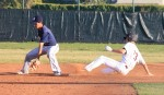 Junior Richie Nunis slides in ahead of the tag to pick up a double in the Breakers 3-1 win over San Juan Hills in the second half of a double header on Tuesday, March 12.