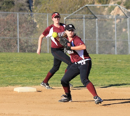 Sophomore second baseman Katyn Ott throws to first for the put out during Laguna's season and home opener against Capistrano Valley Christian at the Breaker's Thurston Middle School field.
