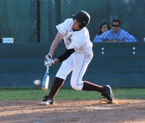 Senior Larry Stewart connects on a low pitch for a single in Laguna's 11-2 win over Jurupa.