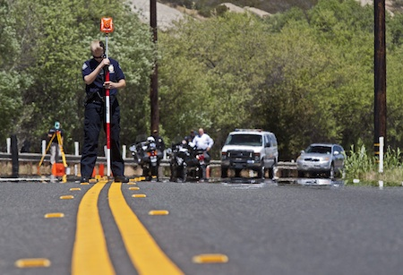 Irvine police investigator Allyson Maddy assists with the Laguna Canyon double fatality investigation in April.  Photo by Mitch Ridder