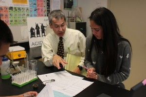 Science teacher Steve Sogo with student Imaan Ali.