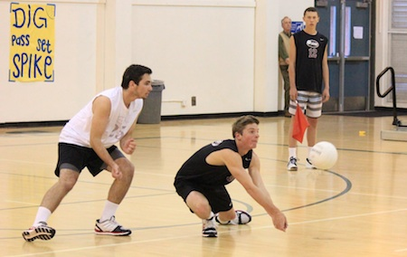 Jake Hexberg digs verses Saddleback this past Tuesday. The junior three-varsity sport athlete recorded 14 digs and 6 kills in the Breakers sweep of Saddleback. Adam Lythgoe looks on.