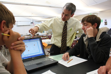 Student Andrew Couse receives an explanation from science teacher Steve Sogo.