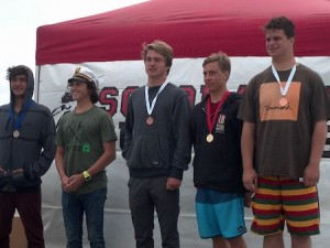 In the longboard finals, locals include Tobie Grierson, center; Cameron DePfyffer, second from right; and Eric Siegrist, far right.