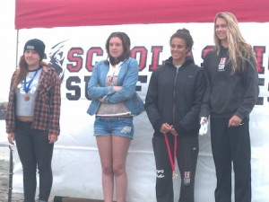 In the girls longboard finals, locals Marlee Grosher, second from right, and Coco Putnam, far right.