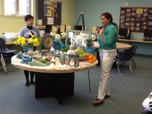 Farah Farvizi, right, describes her Nowruz display.