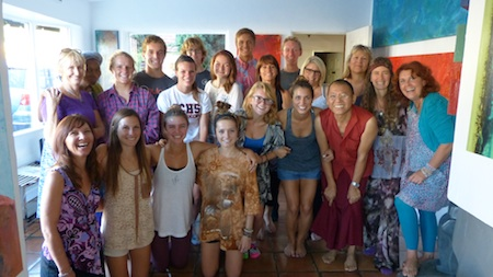 Teens and parents from San Clemente and Laguna Beach meet with Sobonfu Some, second from left, president of Wisdom Spring, and monk Yeshi Dorjee, whose village is in need of water.