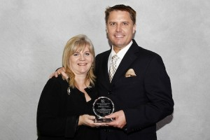 Todd Orlich, Montage's general manager, right, accepts an award from Tresa Oliveri, Regional Center board chair.
