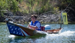 LBHS student Andrew Couse guides the sun-powered boat during a regional race. Photo courtesy of the Metropolitan Water District.