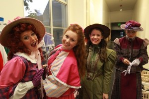 "Cast members of ""Hello, Dolly"" clown around before the high school's spring musical in March. Photo by Roark Gourley"