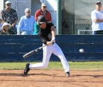 Richie Nunis about to connect for one of his two hits against Calvary Chapel.
