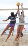 Geena Urango tries to loft one over Lisa Ruthledge during the finals.