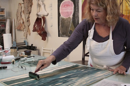 Printmaker Sheryl Seltzer at work in her Canyon Artists Studio.