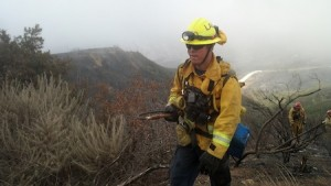 Firefighter Chris Ornelas comes up to the ridgeline on the Springe fire after putting out a hot spot.