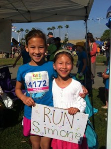 Third-grader Simone Yang is cheered on by her sister, Joelle.