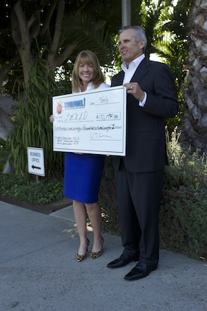 School Power Endowment representatives Robin Rounaghi and Bill Moore present the school district with a $170,000 check.