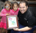 Makayla and Keilani show their appreciation to Chef Amar Santana.