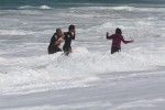 Skimboarder Rescues Infant Swept to Sea