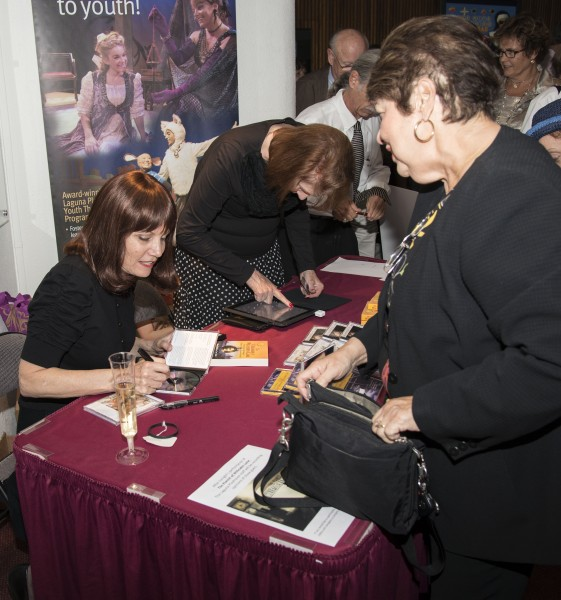 Performer Mona Golabek signing a book about her mother's life after escaping Vienna, on which the play is based.  Photo by Charles Weinberg