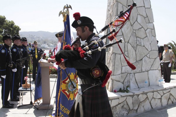 Firefighter-bagpiper David Lopez at Monument Point.