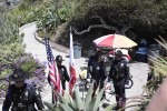 Police color guard prepare for their presentation.