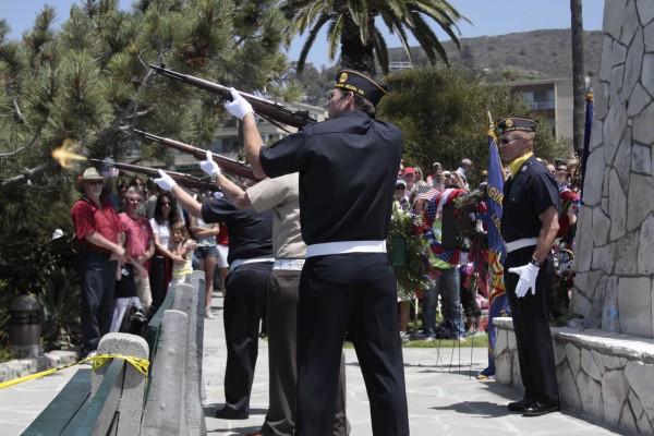 Frank Daniel supervises the rifle detail.