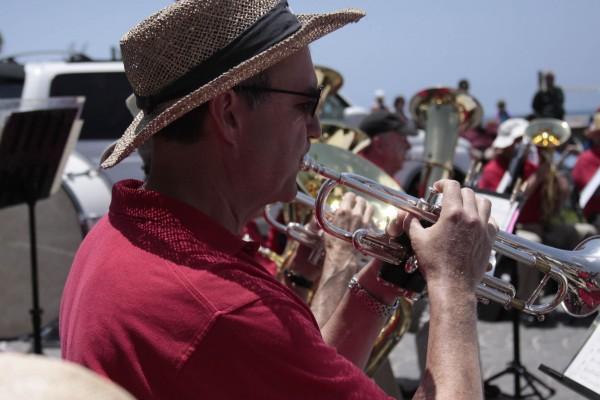 Community Band leader Matt Wood performing in Monday's Main Beach concert.