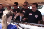 Firefighters volunteered for early duty behind the grill.