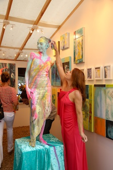 Painter and performance artist Deborah Paswaters reinvisions a living picture with model Ruth Dormaier in her booth at the Sawdust Art Festival, which opens to the public today.