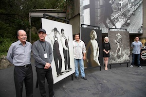 Photographer Rob Gage shows off his movie poster style portraits of Hollywood icons and local impersonators, part of a preview of the Pageant of Masters, which opens July 7. Photo by Jody Tiongco