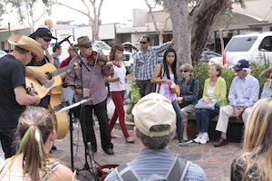 Passerby enjoyed the Grey Hill Gospel String Band, who will return to their Forest and Glenneyre Street venue this year.