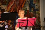 Joan Hantman singing with a Bulgarian band at a recent Laguna Folkdance Festival.