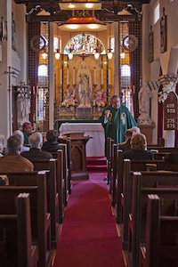 Father Jack Kearney celebrates mass at St. Francis by the Sea.