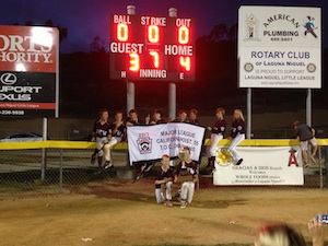 Photo by Mike Embury  Triumphant VFW players and their trophy.