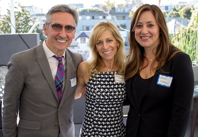 Photo by Ryan Cavanuagh: Directory Chair Melissa Cavanuagh, center, with Morrison Hair salon owners James and Rachel Morrison.