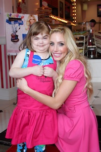 Casey Reinhardt with Sarah, a Make a Wish Foundation recipient.