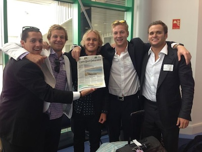 From left: Rex Miller and Dylan McDonald, of Laguna Beach; Cole Moody of Laguna Niguel; Robbie McKnight, also of Laguna; and JB Green of Newport Beach; with their hometown paper before their next adventure.