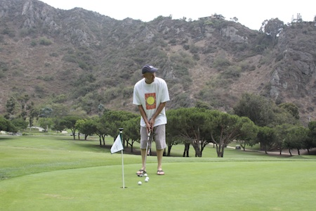 Blues artist and local resident John Heussenstamm, practices on the Aliso Creek putting green.