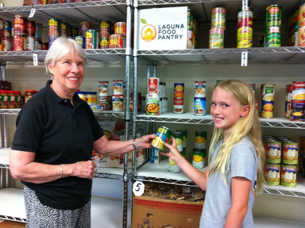 Marianna Hof and Katelyn Kolberg prepare for the Kids' Day of Service at the Laguna Food Pantry.