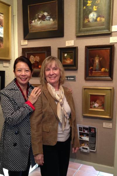 Florida resident Chi Cook, left, visiting with Mary Jo Querry at Quorum Gallery, one of the town's longest-lived galleries.