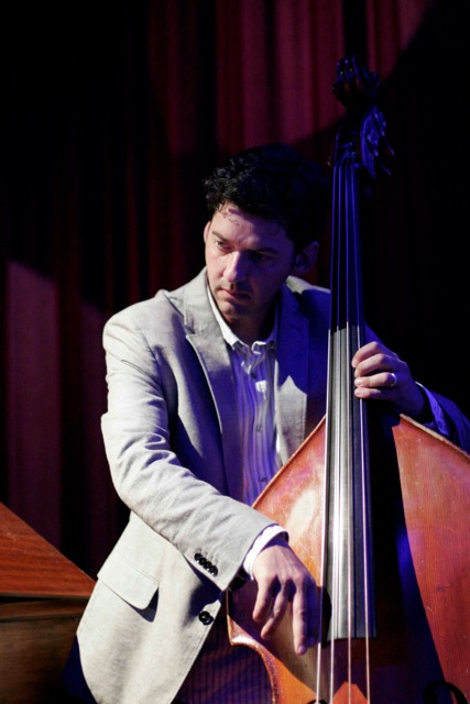Roger Shew playing upright bass in 2013.