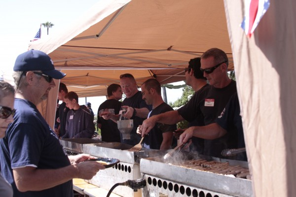 Firefighters pitch in at Exchange Club's pancake breakfast in May.