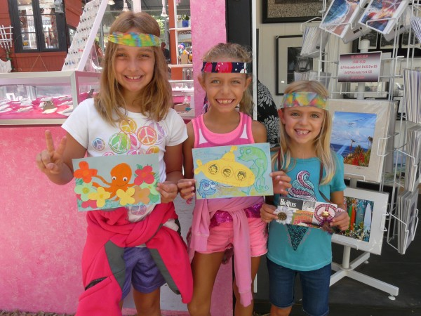 Visitors Annika Hayes, Corinne Kopp and Marissa Hayes with Sawdust Festival arts projects inspired by Beatles Day, set for Saturday, Aug. 17.