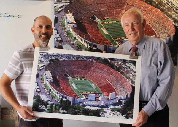 Artist Fabrice Spies, left, and former pro football coach John Robinson.