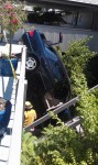 Vehicle Plummets Off Carport