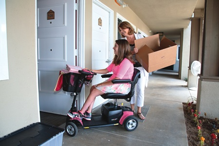 Paula Scivers lends a hand to her daughter Carissa, one of the first residents moving into Laguna Beach's Glennwood House.