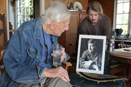 Artist Paul Darrow with his grandson Bryce and an early self-portrait.