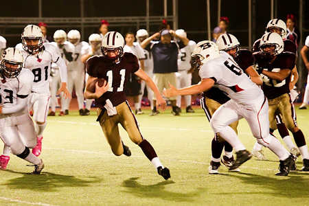 Keaton Martinez threads through the defense. Photo by Collin Goddard