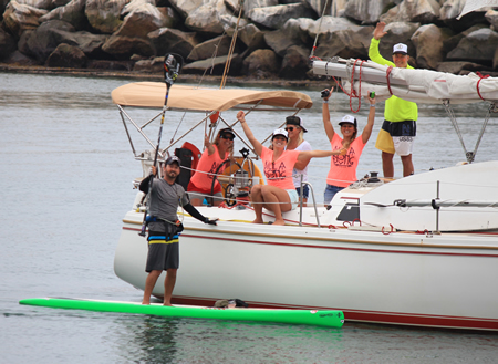 Will Schmidt along with his support crew at paddle's end, coming into Dana Point Harbor.