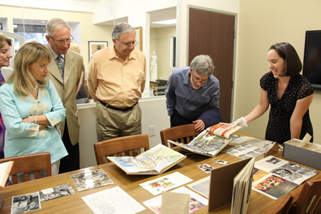 College President Jonathan Burke and other guests inspect Brandt's archives.